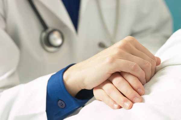 Doctor holding patient hand 2